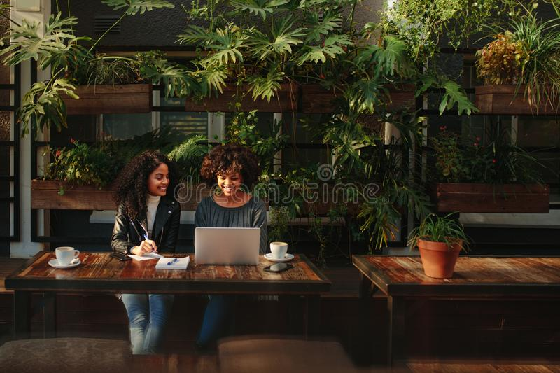 Women discussing ideas over coffee stock photography