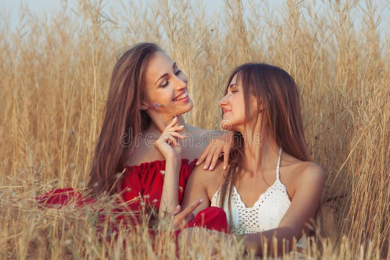 Two women are smiling. Two women are smiling, they are enjoying fellowship with each other stock images