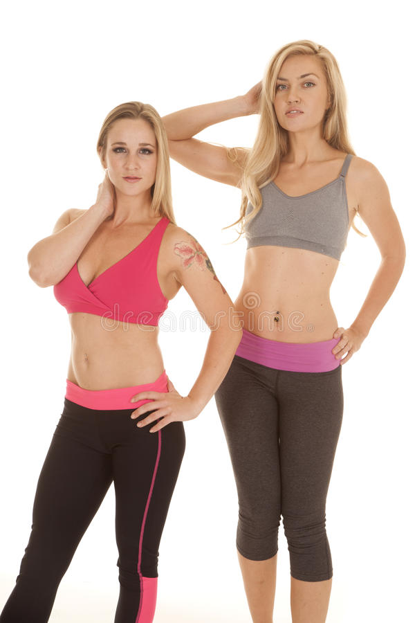 Two women sports bras fitness stand stock image