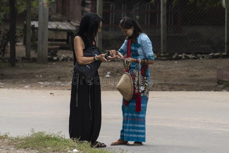 Two women haggling a souvenir royalty free stock photography
