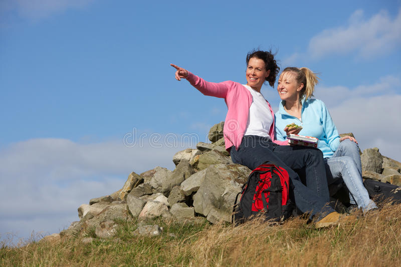 Two Women Stopping For Lunch On Countryside Walk. Pointing stock image