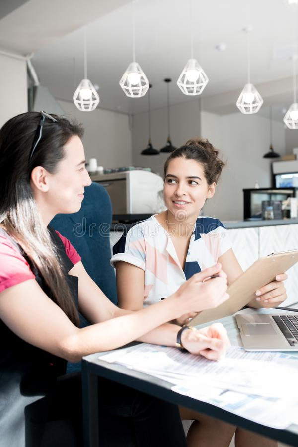 Two Women Studying in Cafe royalty free stock photo