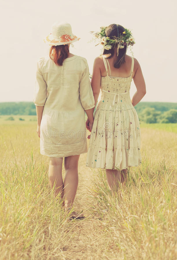 Two women on summer field stock image