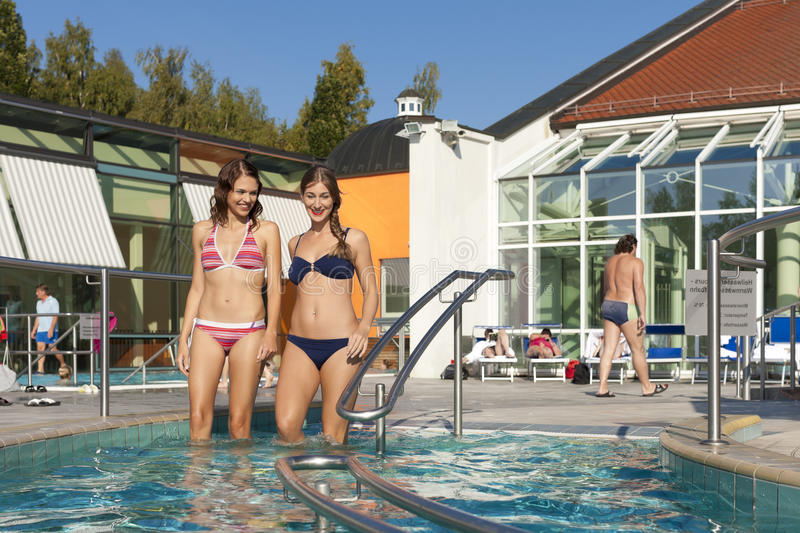 Download Two women in swimming pool stock photo. Image of people - 24875646