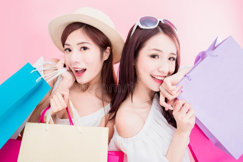 Two women take shopping bags stock images
