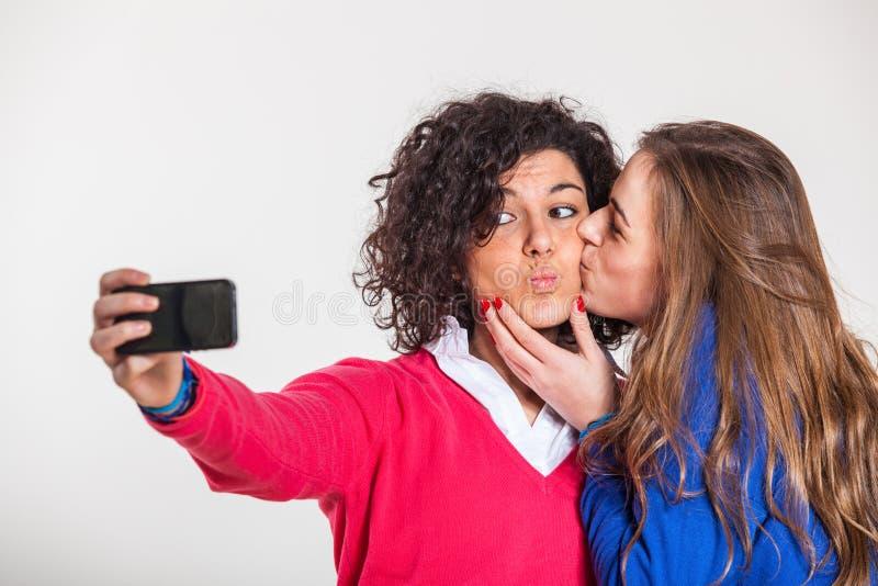 Two Women Taking Self Portrait royalty free stock photos
