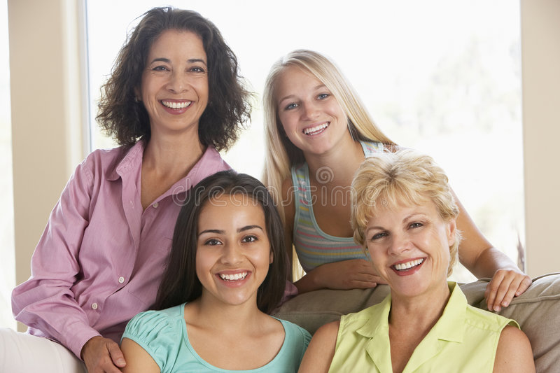 Two Women And Their Teenage Daughters stock photos