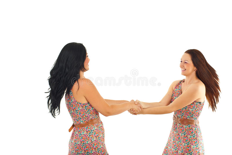 Two women twirl together royalty free stock photo