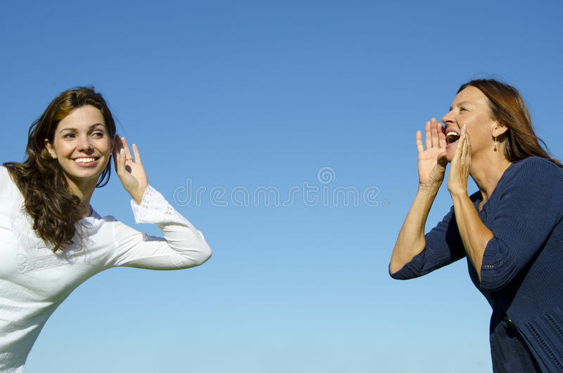 Two women, two generations, communicating stock images