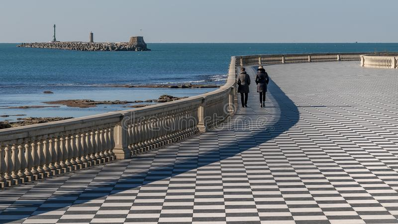 Two women walk on the Mascagni Terrace in Livorno on a beautiful sunny day, Tuscany, Italy. Europe stock image