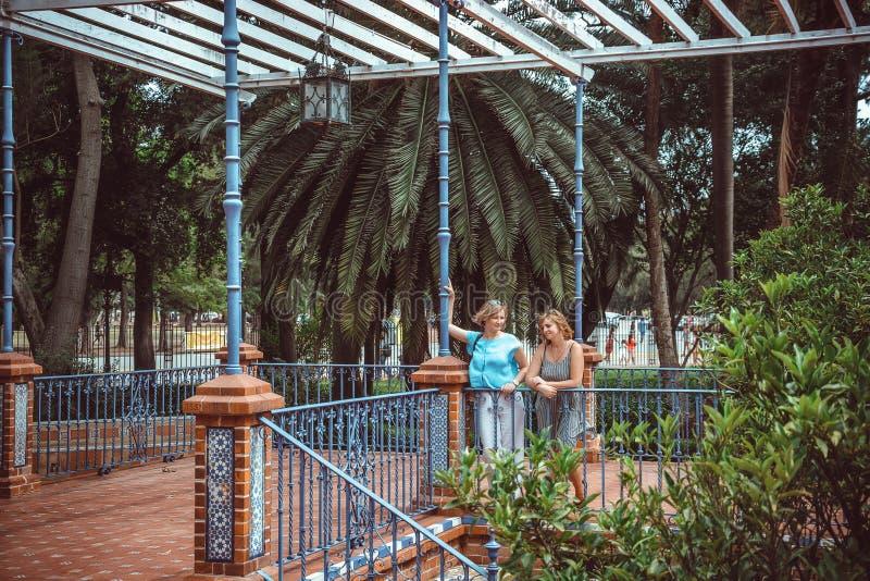 Two women on walk in park. Happy two women on walk in park stock photo