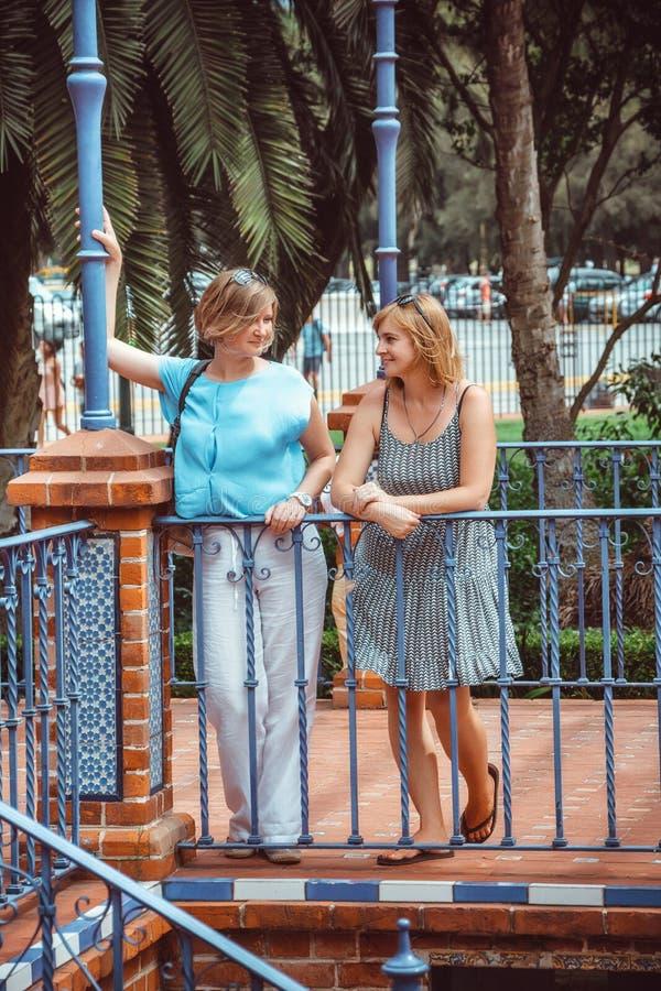 Two women on walk in park. Happy two women on walk in park stock image