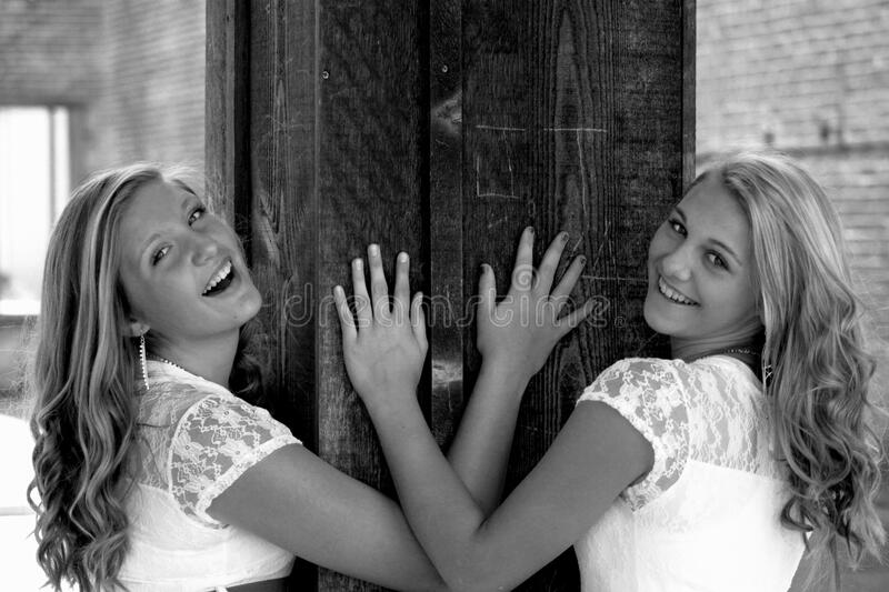Two Women Wearing White and Lace Tops Smiling stock photos