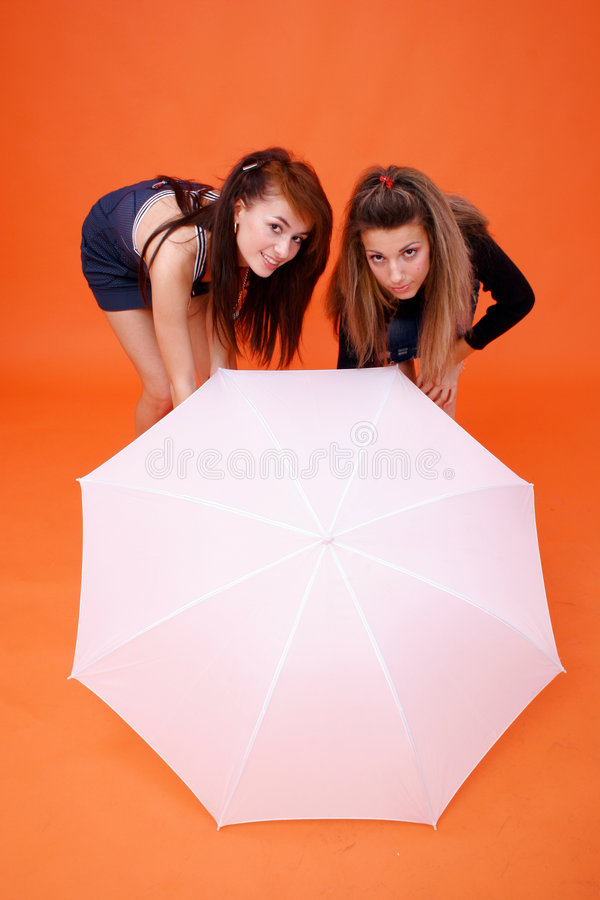Two Women And A White Umbrella royalty free stock photography