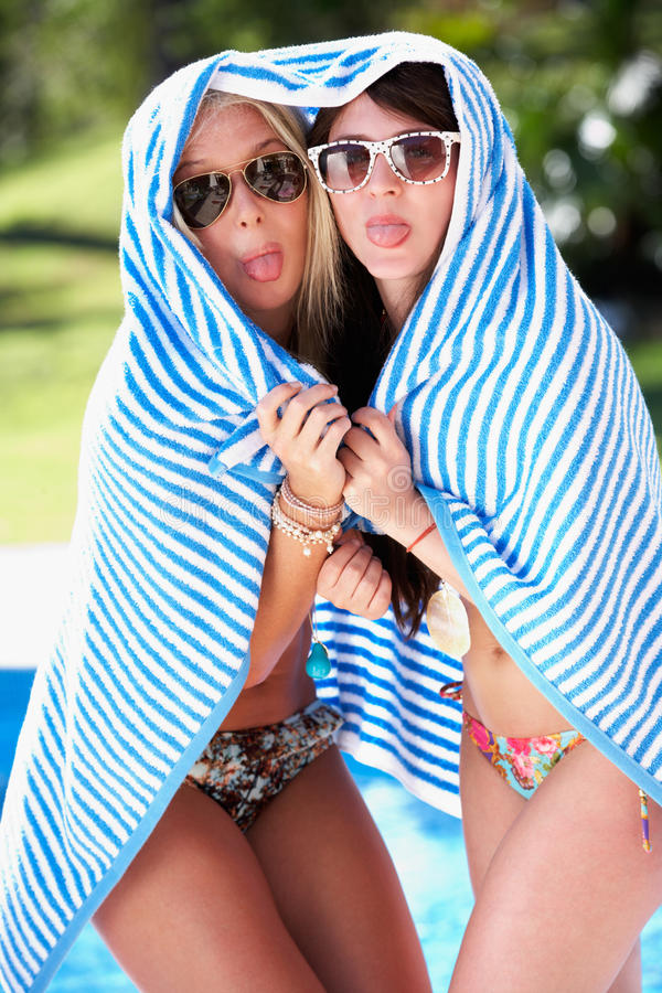 Download Two Women Wrapped In Towel Pool Stock Photo - Image: 27435452