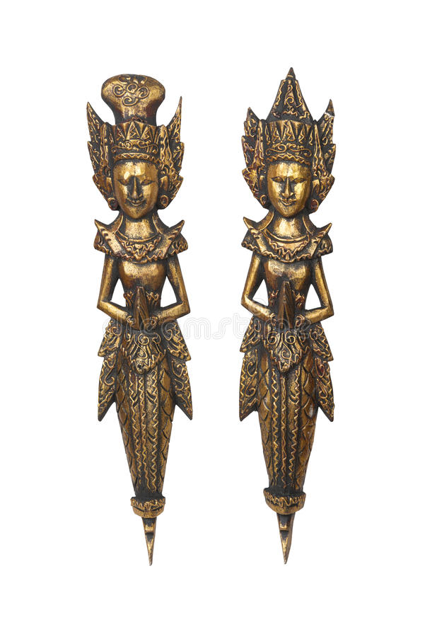 Two wood carved statues royalty free stock photography