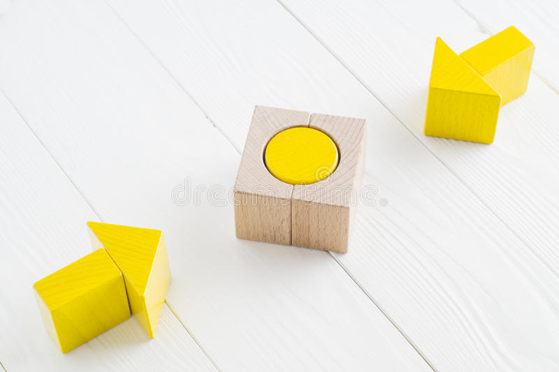 Two wooden arrows converge towards the center target. Symbol of goal and objective. Two wooden arrows converge towards the center target. Arrows pointing to the stock image