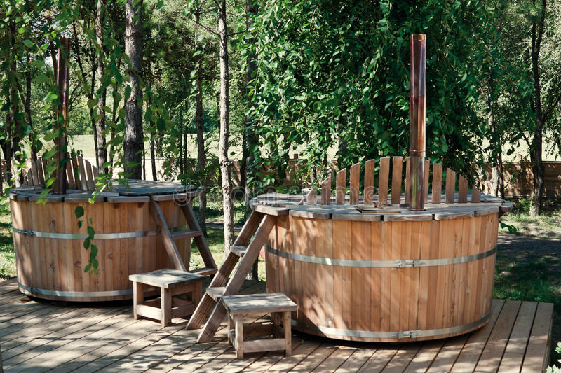 Two wooden bathtubs royalty free stock images
