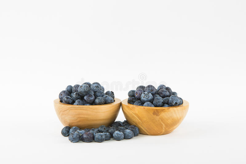Two Wooden Bowls of Blueberries stock photography
