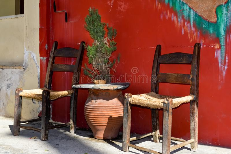 Two wooden chairs with a braided bottom royalty free stock photos
