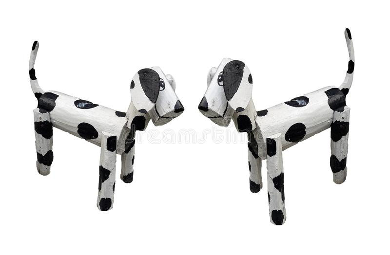 Two wooden dogs standing white mixed black colors isolated on white background. Animal, art, painted, dot, puppy, doggy, decoration, design, handmade, style stock photo