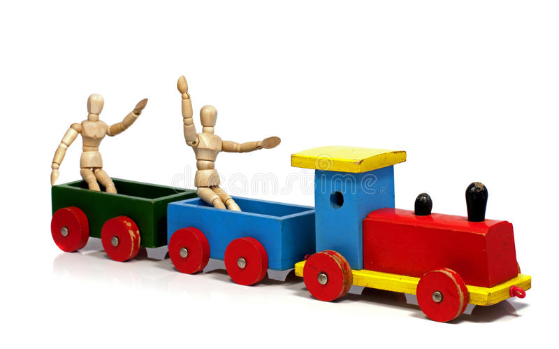 Download Two Wooden Dolls Sitting On A Train Stock Image - Image: 25861759