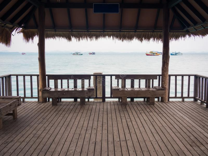 Two wooden empty benches at a pier in Thailand royalty free stock photos