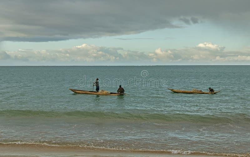 Two wooden fishing boats at sea. Toamasina, Madagascar stock photography