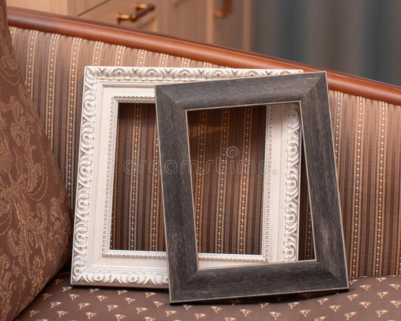 Two wooden frames on the sofa royalty free stock image