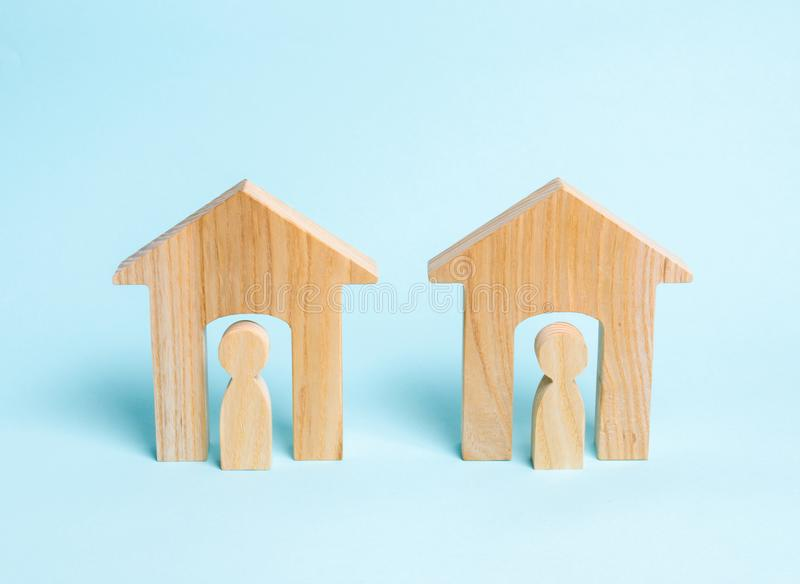 Two wooden houses with neighbors. Two neighbors. Good neighborhood, district. Communication, communication between two people royalty free stock photos