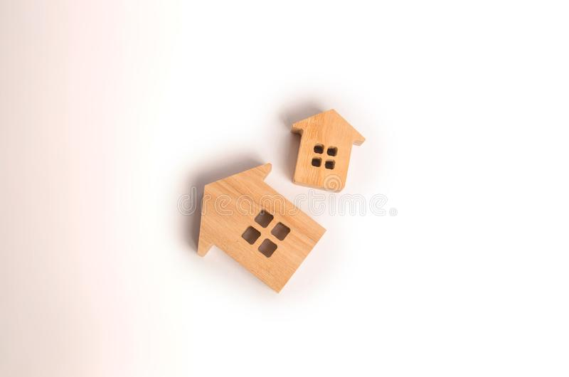 Two wooden houses on a white background. Concept of real estate, buying and selling. Rent. Statistical data. Minimalism. Investmen stock photo