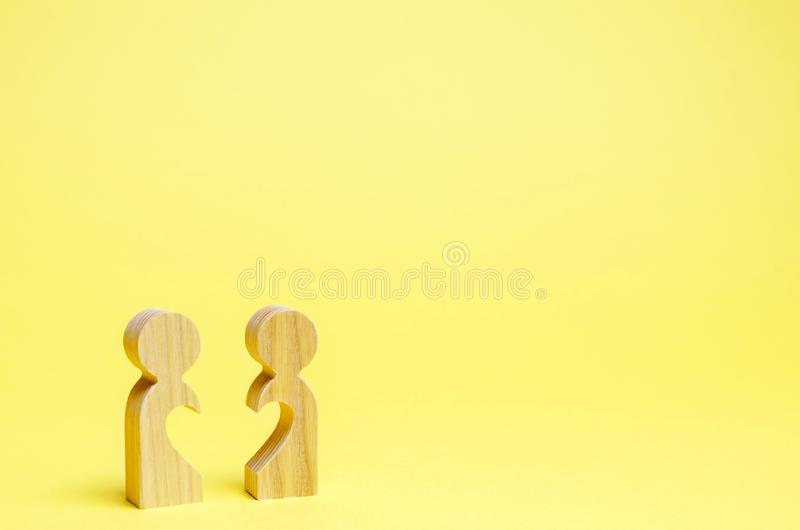 Two wooden man with half a heart. Search for a soul mate. Flirt and sympathy. Human relations. Love of all life. Meeting lovers. Divorce and breakup. Two stock photography
