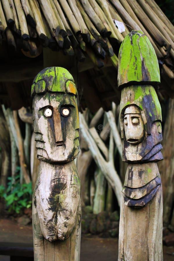 Two wooden totems (idols) near royalty free stock photo