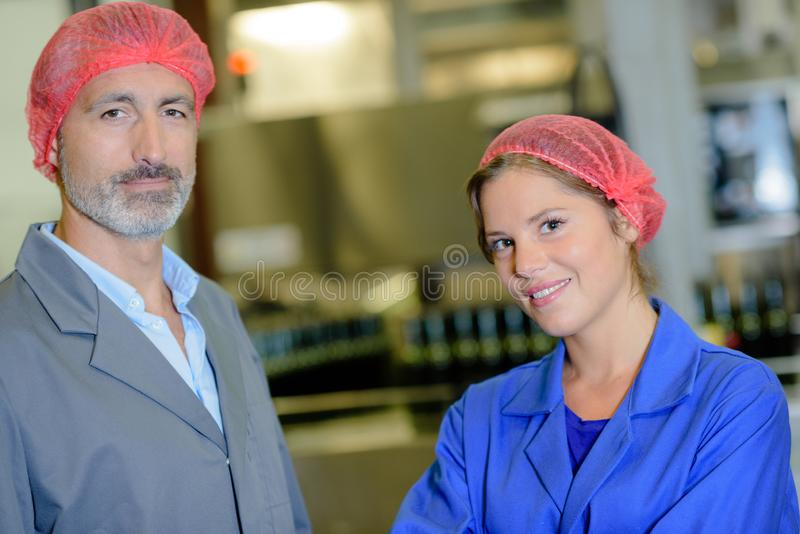 Two workers posing in factory. Man stock photos