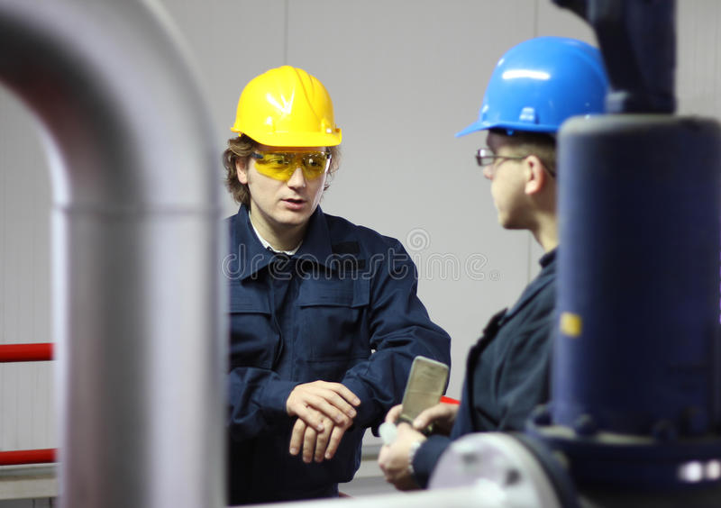 Two workers talking royalty free stock photos