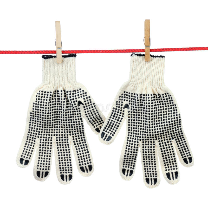 Two working gloves. Two gloves on the clothesline over white background stock images