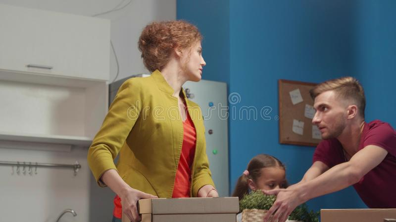 Family removes and pack boxes. royalty free stock photography