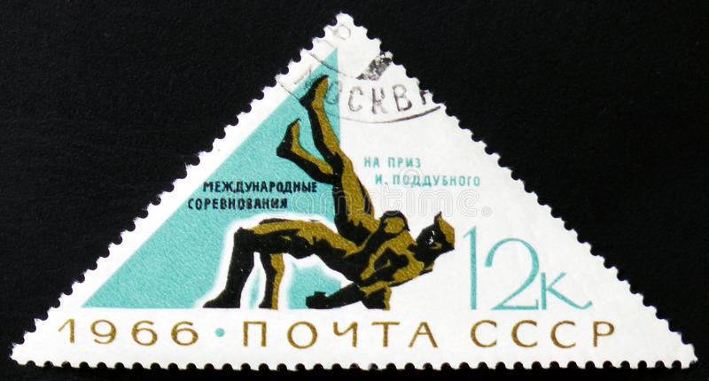 Two wrestlers, circa 1966. MOSCOW, RUSSIA - FEBRUARY 12, 2017: A stamp printed by USSR shows two wrestlers, devoted to International wrestling competitions for stock photos