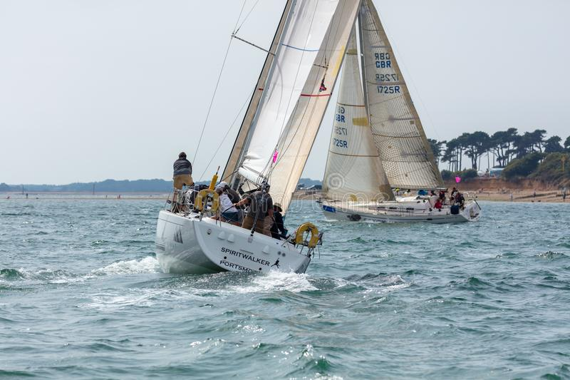 Two Yachts Racing close to Shore. The Solent, Hampshire, UK; 7th August 2018; Two Yachts Race Close to the Shore During the Cowes Week Regatta royalty free stock image