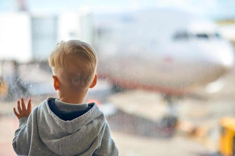 Two year old boy at the airport stock photo