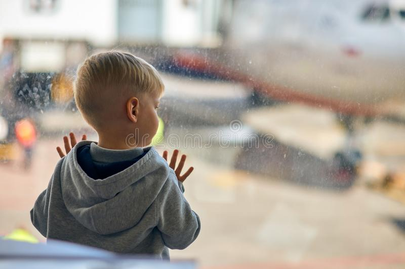 Two year old boy at the airport royalty free stock photo