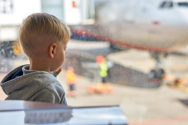 Two year old boy at the airport stock image