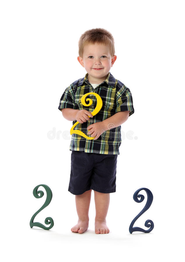 A Two Year Old Holds a Number Two stock photography
