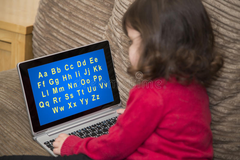 Two year old learning alphabet royalty free stock photos