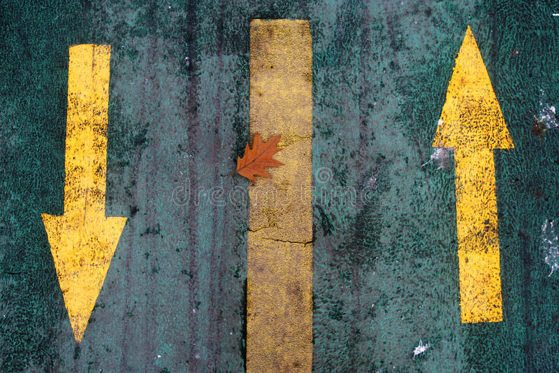 Two yellow arrows. Pointing oposite royalty free stock image