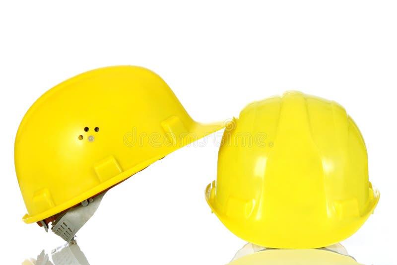 Two yellow helmet stock image