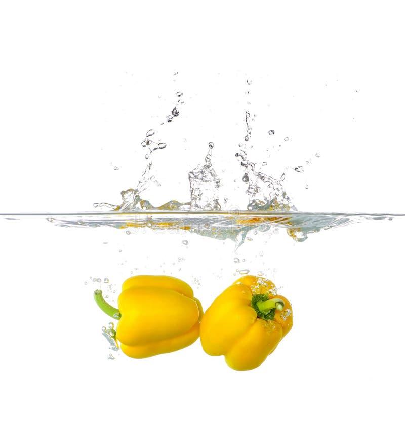 Two Yellow Paprika Splash in Water stock image