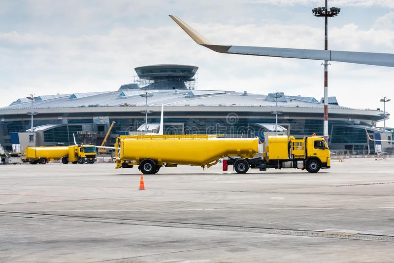 Two yellow tank truck aircraft refuelers royalty free stock photo