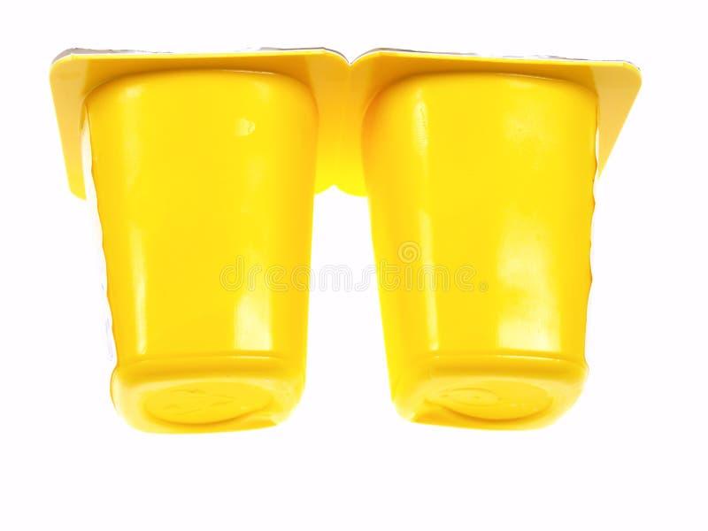 Two Yellow Yogurt Containers stock photo