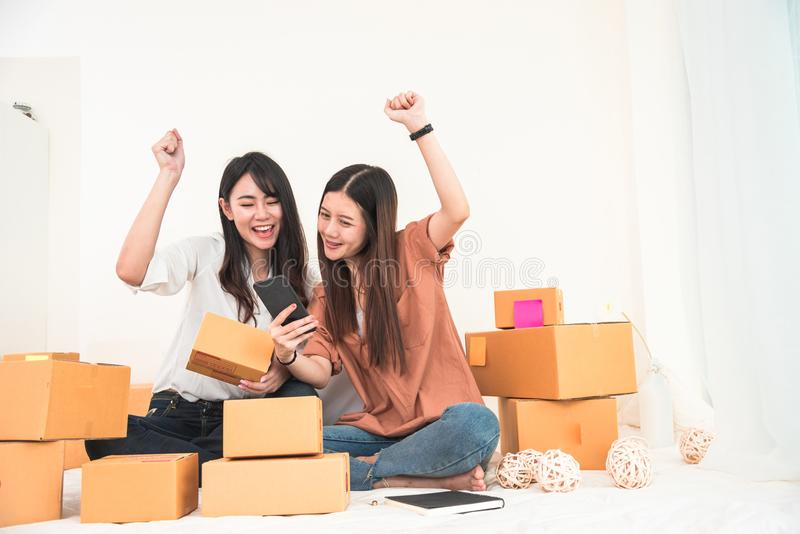Two young Asian woman startup small business entrepreneur SME di royalty free stock photo